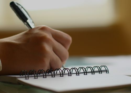 Person writing, seminar Geneva, La Mainaz