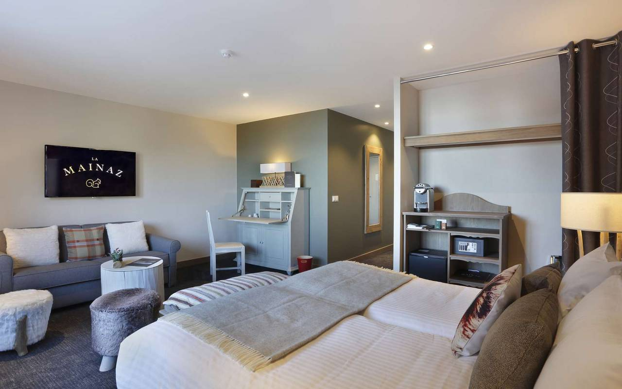 Well equipped room with bed and sofa, hotel divonne les bains, La Mainaz.
