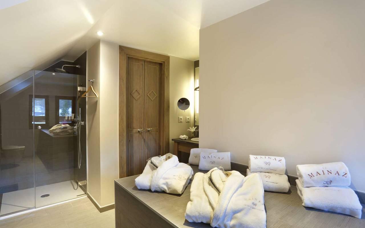 Bathroom with walk-in shower and bathrobe, luxury hotel jura, La Mainaz.